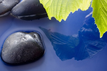 smooth stones in water.jpg